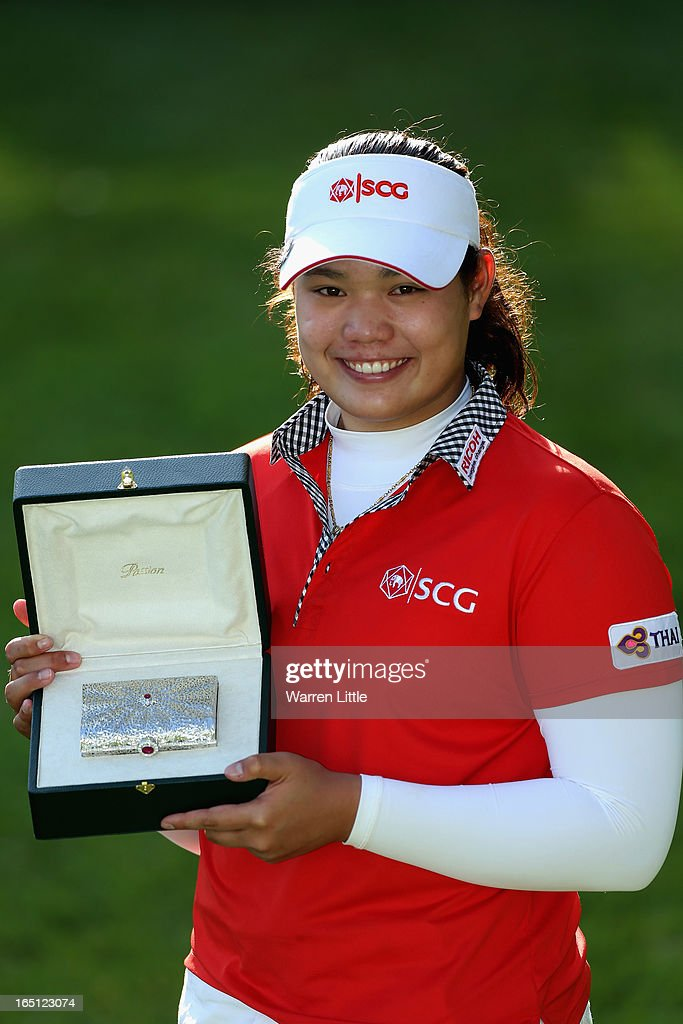 Ariya Jutanugarn of Thailand poses with the trophy after winning the Lalla Merem Trophy pictured after the Trophee du Hassan II Golf at Golf du Palais Royal on March 31, 2013 in Agadir, Morocco.