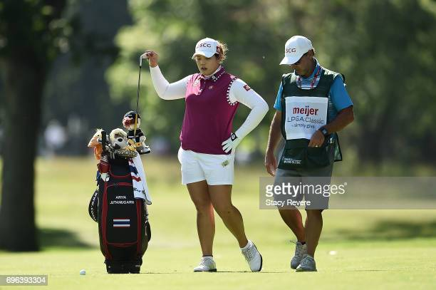Ariya Jutanugarn of Thailand pulls a club from her bag on the 15th hole during the first round of the Meijer LPGA Classic at Blythefield Country Club...