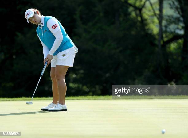 Ariya Jutanugarn of Thailand putts on the 14th green during the US Women's Open round one on July 13 2017 at Trump National Golf Course in Bedminster...