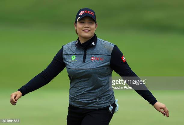 Ariya Jutanugarn of Thailand smiles after sinking her putt on the 1st green during the final round of the Manulife LPGA Classic at Whistle Bear Golf...