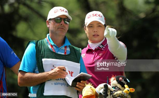 Ariya Jutanugarn of Thailand talks to her caddie on the 9th tee during the first round of the Meijer LPGA Classic golf tournament at Blythefield...