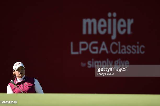 Ariya Jutanugarn of Thailand watches her chip shot on the 17th green during the first round of the Meijer LPGA Classic at Blythefield Country Club on...