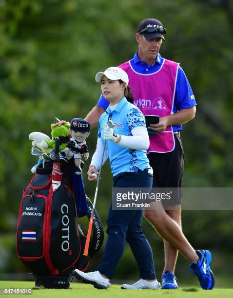 Ariya Jutanugarn of Thailand with her caddie during the weather delayed first round of The Evina Championship at Evian Resort Golf Club on September...