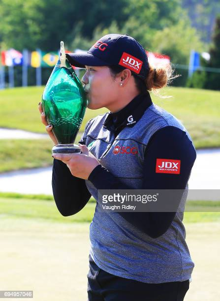 Ariya Jutanugarn of Thailand with the trophy after sinking her birdie putt on the 1st playoff hole to win during the final round of the Manulife LPGA...