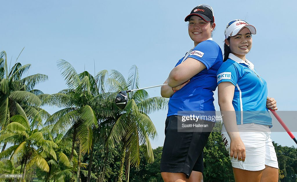 Ariya Jutanugarn (L) poses with her sister Moriya after the second round of the HSBC Women's Champions at the Sentosa Golf Club on March 1, 2013 in Singapore, Singapore.