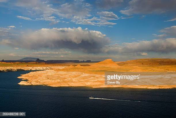 USA, Arizona, boat on Lake Powell, Navajo Mountain visible in distance