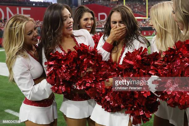 Arizona Cardinals cheerleader Nikki reacts after being named to the pro bowl game during the NFL game against the Los Angeles Rams at the University...