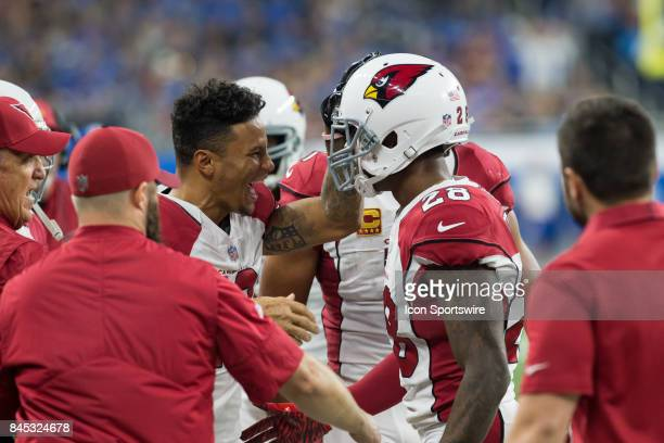 Arizona Cardinals corner back Justin Bethel is congratulated by Arizona Cardinals wide receiver Brittan Golden on the sidelines after he returned an...