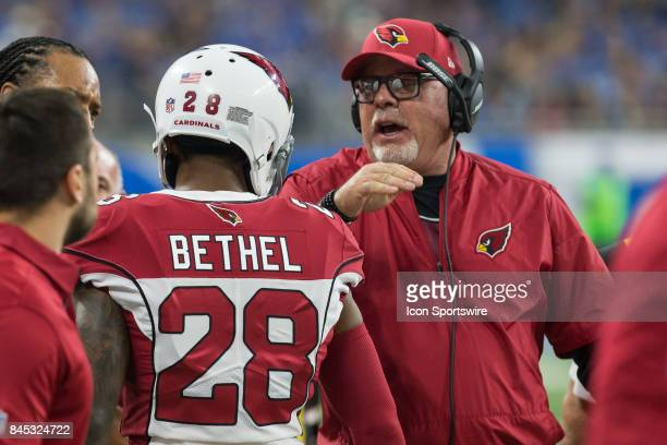 Arizona Cardinals corner back Justin Bethel is congratulated by Arizona Cardinals head coach Bruce Arians on the sidelines after he returned an...