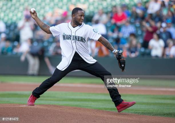 Arizona Cardinals draft pick Budda Baker throws out the first pitch before a game between the Oakland Athletics and the Seattle Mariners at Safeco...