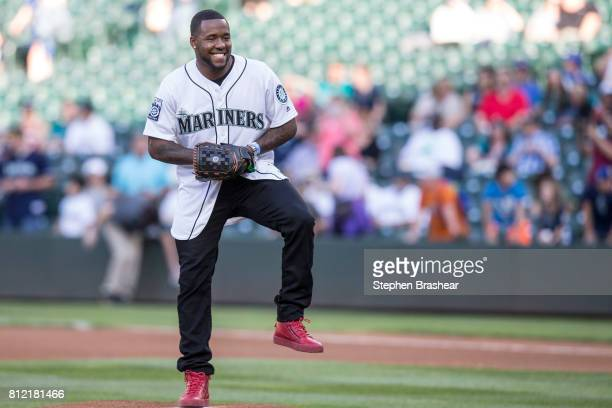 Arizona Cardinals draft pick Budda Bakers jokes around before throwing out the first pitch before a game between the Oakland Athletics and the...