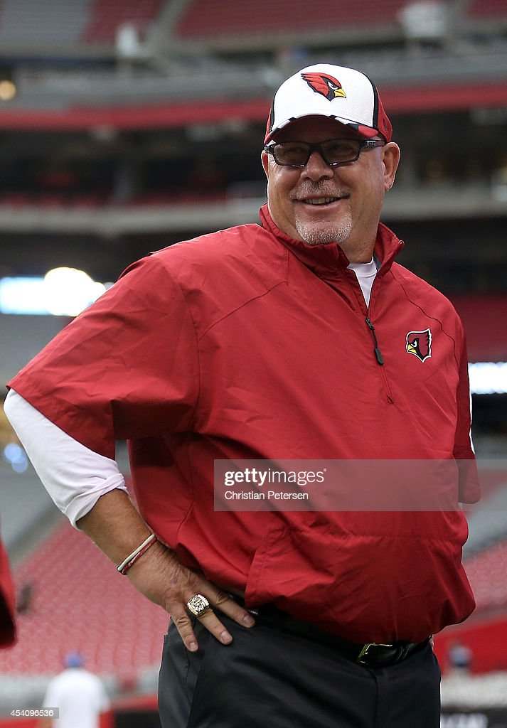 Arizona Cardinals head coach Bruce Arians talks on the sideline before the preseason NFL game between the Cincinnati Bengals and the Arizona Cardinals at the University of Phoenix Stadium on August 24, 2014 in Glendale, Arizona.