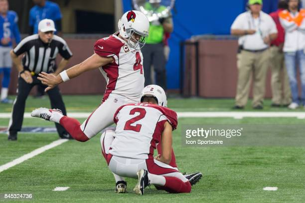 Arizona Cardinals kicker Phil Dawson kicks an extra point during first quarter game action between the Arizona Cardinals and the Detroit Lions on...