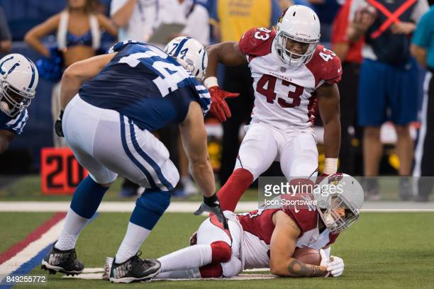 Arizona Cardinals safety Tyrann Mathieu secures a interception in overtime during the NFL game between the Arizona Cardinals and Indianapolis Colts...