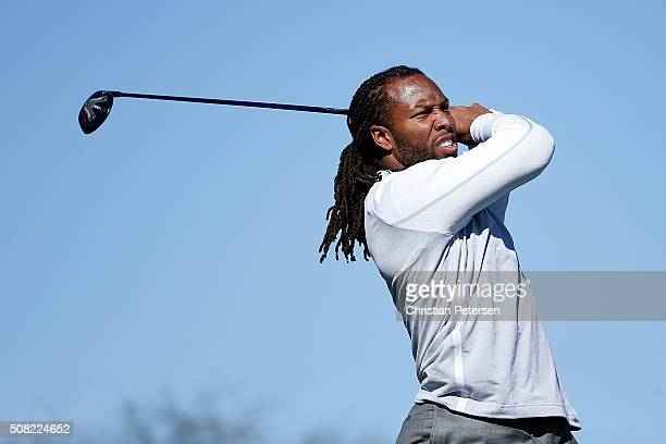 Arizona Cardinals wide receiver Larry Fitzgerald hits a tee shot on the 15th hole during the proam for the the Waste Management Phoenix Open at TPC...