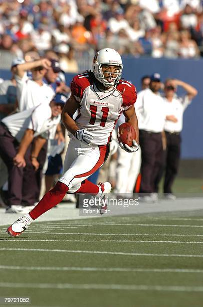 Arizona Cardinals wide receiver Larry Fitzgerald looks for open field against the New York Giants at Giants Stadium in East Rutherford NJ on...