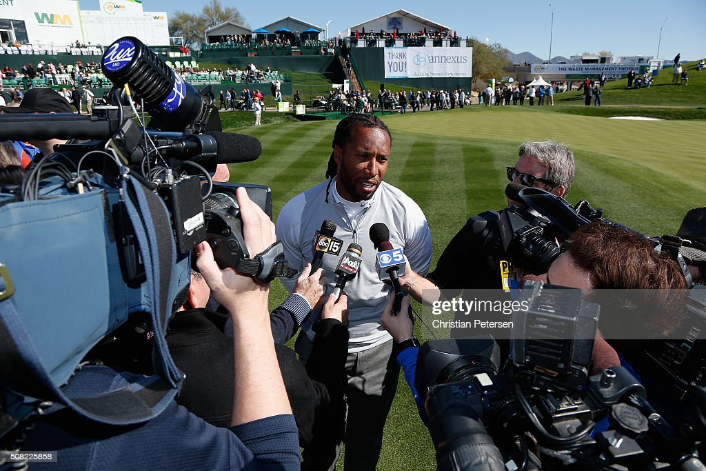 Arizona Cardinals wide receiver Larry Fitzgerald speaks with the media off the 18th green following the pro-am for the the Waste Management Phoenix Open at TPC Scottsdale on February 3, 2016 in Scottsdale, Arizona.