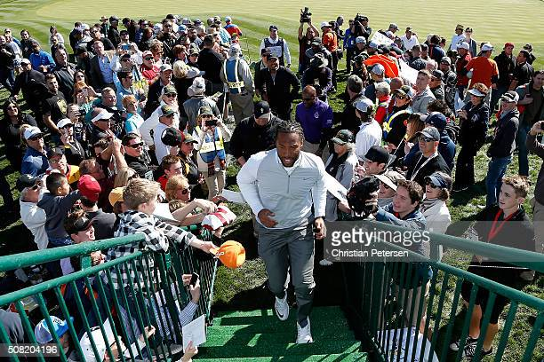 Arizona Cardinals wide receiver Larry Fitzgerald walks off the 18th green following the proam for the the Waste Management Phoenix Open at TPC...