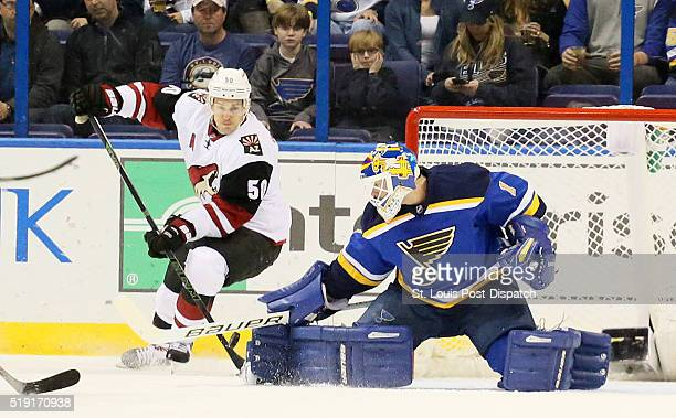 Arizona Coyotes center Antoine Vermette scores past St Louis Blues goaltender Brian Elliott during the first period on Monday April 4 at the...