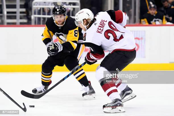 Arizona Coyotes Center Mario Kempe tries to the skate the puck past Pittsburgh Penguins Defenseman Brian Dumoulin during the first period in the NHL...