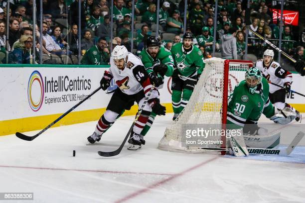 Arizona Coyotes center Zac Rinaldo and Dallas Stars center Tyler Seguin chase the puck behind the net during the game between the Dallas Stars and...