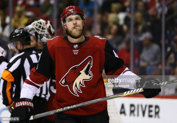 Arizona Coyotes defenseman Kevin Connauton stays warm during a break in the action during the NHL hockey game between the New Jersey Devils and the...
