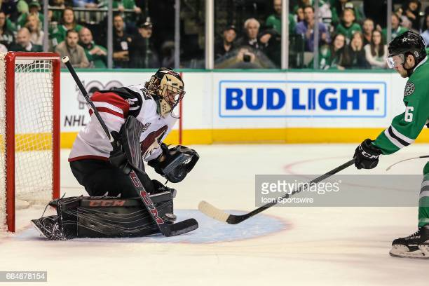 Arizona Coyotes goalie Mike Smith blocks a shot against Dallas Stars center Jason Dickinson during the game between the Dallas Stars and the Arizona...