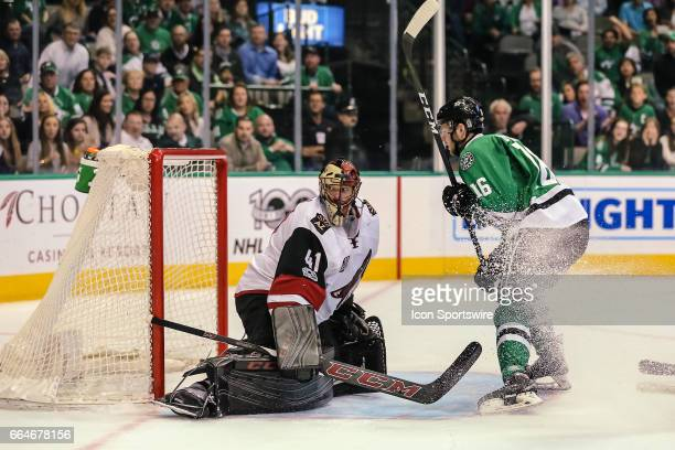 Arizona Coyotes goalie Mike Smith misses a shot by Dallas Stars center Jason Dickinson for a goal during the game between the Dallas Stars and the...