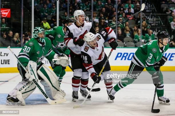 Arizona Coyotes right wing Christian Fischer and left wing Lawson Crouse set up in front of Dallas Stars goalie Ben Bishop with help from defenseman...