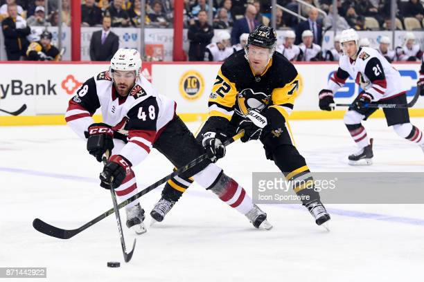 Arizona Coyotes Winger Jordan Martinook and Pittsburgh Penguins Right Wing Patric Hornqvist go for the puck during the first period in the NHL game...