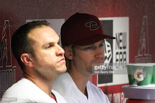Arizona Diamondbacks battery mates Miguel Montero and Bronson Arroyo in the dugout during the Major League Baseball game between the Miami Marlins...