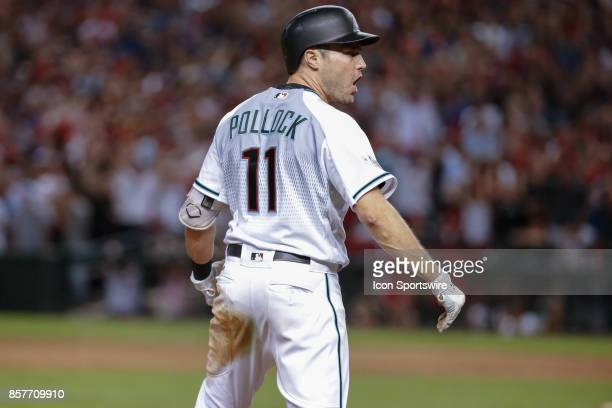 Arizona Diamondbacks center fielder AJ Pollock celebrates after hitting a triple during the MLB National League Wild Card baseball game between the...