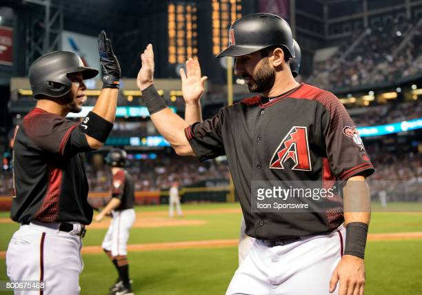 Arizona Diamondbacks center fielder Gregor Blanco highfives left fielder Daniel Descalso and second baseman Brandon Drury after Descalso and Drury...