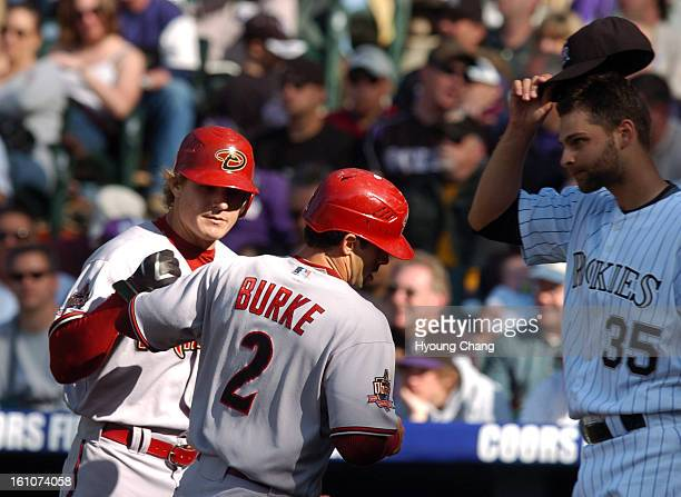ROXOPENER3 Arizona Diamondbacks Eric Byrenes left and Chris Burke celebrate Burke's scoring by Colorado Rockies pitcher Taylor Buchholz in the 7th...