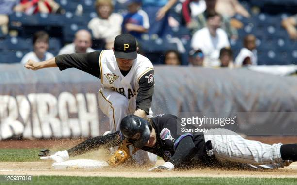 Arizona Diamondbacks Eric Byrnes is tagged out by Pittsburgh's Freddy Sanchez during action at PNC Park in Pittsburgh Pennsylvania on June 19 2006