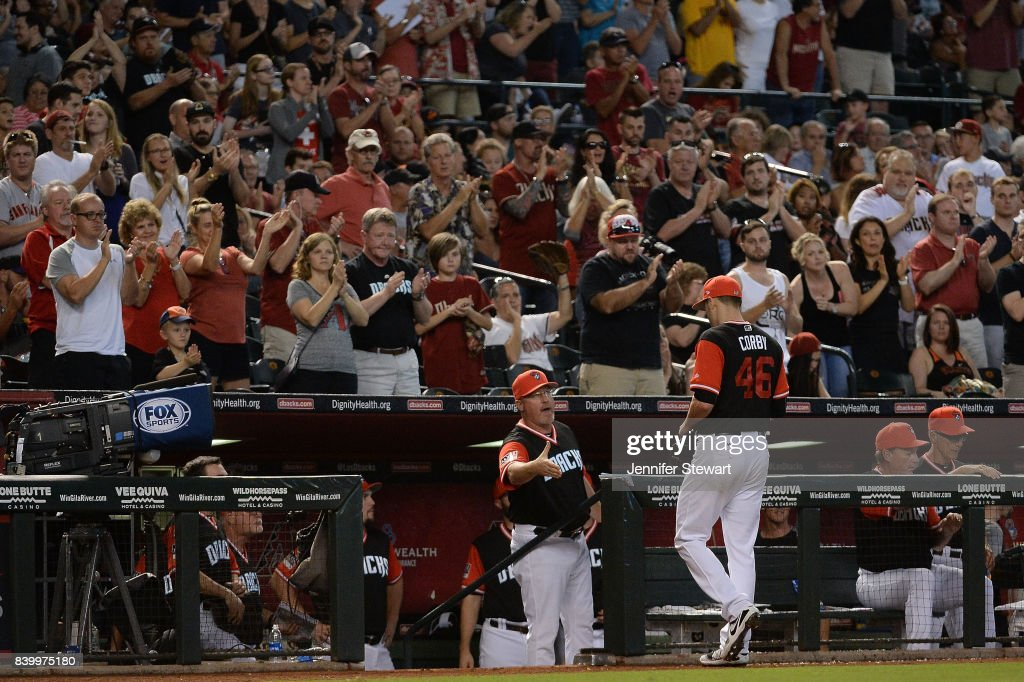 Arizona Diamondbacks fans cheer as Patrick Corbin #46 of the Arizona Diamondbacks is relieved in the eighth inning of the MLB game against the San Francisco Giants at Chase Field on August 27, 2017 in Phoenix, Arizona.