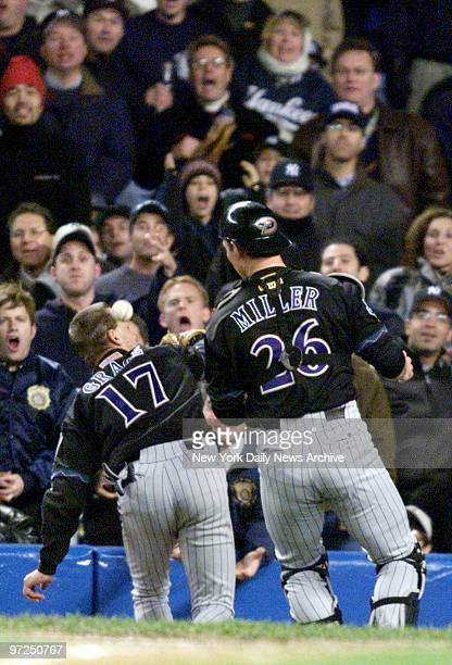 Arizona Diamondbacks' first baseman Mark Grace bumps into catcher Damian Miller resulting in neither of them catching foul ball hit behind the plate...