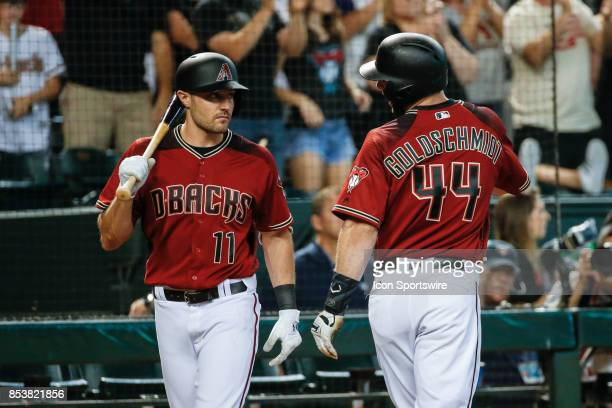 Arizona Diamondbacks first baseman Paul Goldschmidt discusses strategy with Arizona Diamondbacks center fielder AJ Pollock during the MLB baseball...