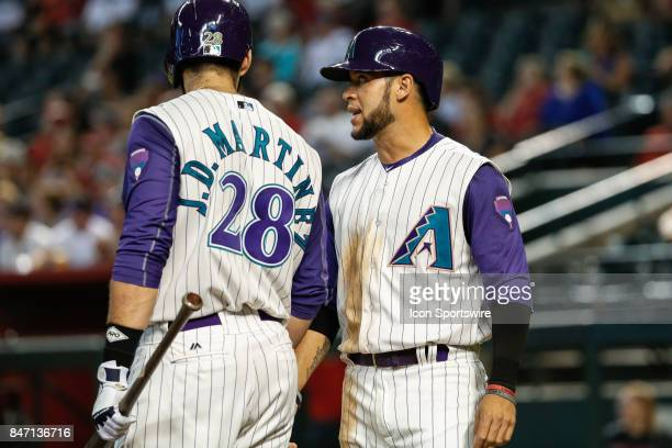 Arizona Diamondbacks left fielder Gregor Blanco and Arizona Diamondbacks right fielder JD Martinez discuss strategy during the MLB baseball game...