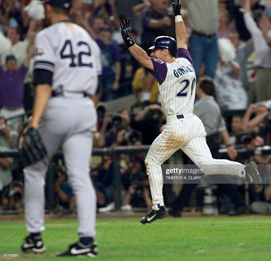 Arizona Diamondbacks left fielder Luis Gonzalez celebrates his gamewinning RBI single in the bottom of the 9th inning off of New York Yankees relief...