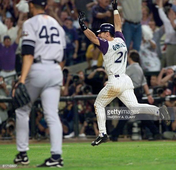 Arizona Diamondbacks left fielder Luis Gonzalez celebrates his gamewinning RBI single in the bottom of the 9th inning off of New York Yankees relief...