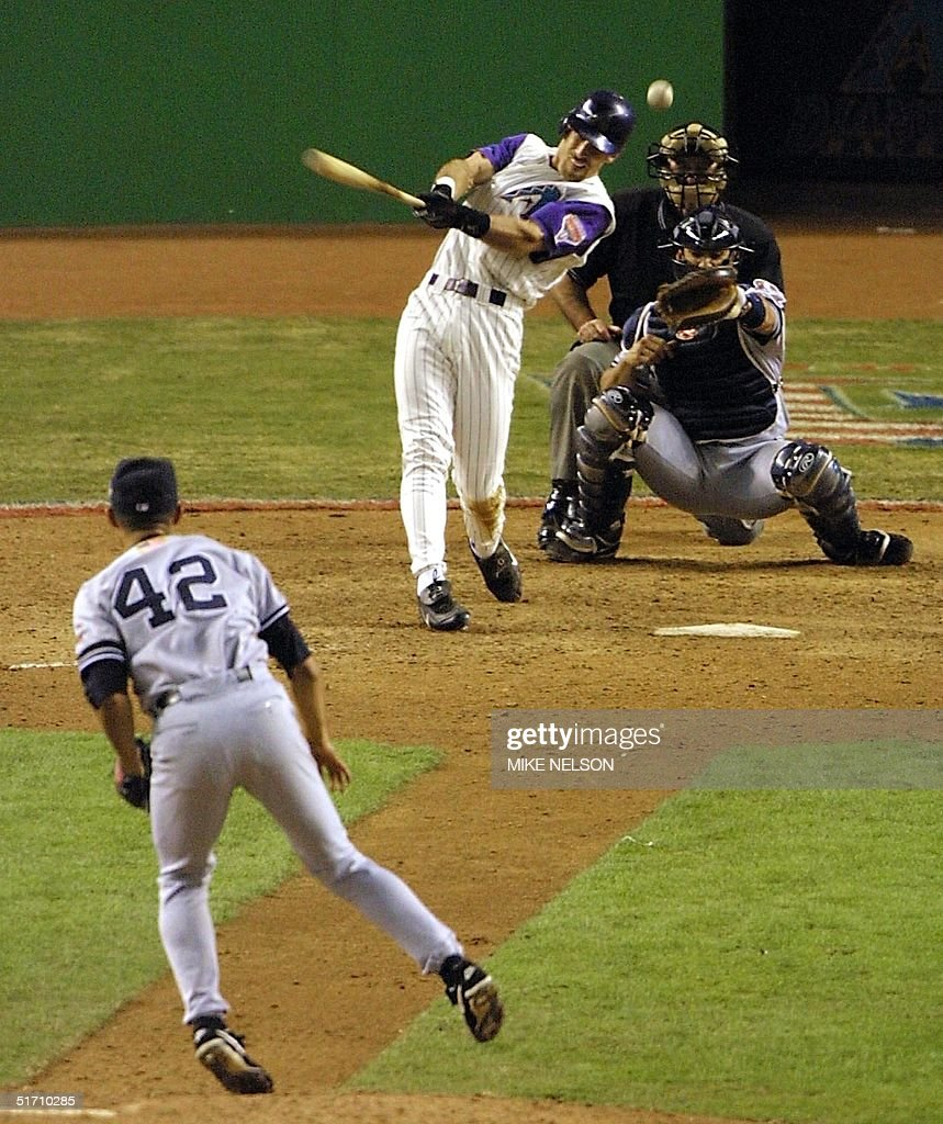 Arizona Diamondbacks left fielder Luis Gonzalez hits his RBI single in the bottom of the 9th inning off New York Yankes relief pitcher Mariano Rivera (#42) which won Game 7 of the World Series for the Diamonbacks in Phoenix 04 November, 2001. The Diamondbacks defeated the New York Yankees 3-2, winning the series four games to three and become the 2001 world champions. AFP PHOTO Mike NELSON
