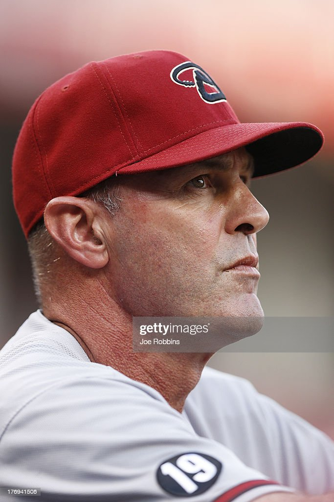 Arizona Diamondbacks manager <a gi-track='captionPersonalityLinkClicked' href=/galleries/search?phrase=Kirk+Gibson&family=editorial&specificpeople=207042 ng-click='$event.stopPropagation()'>Kirk Gibson</a> looks on during the game against the Cincinnati Reds at Great American Ball Park on August 19, 2013 in Cincinnati, Ohio. The Reds won 5-3.