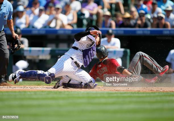 Arizona Diamondbacks Outfielder Gregor Blanco scores safely as Colorado Rockies Catcher Tony Wolters can't apply the tag in time during a regular...