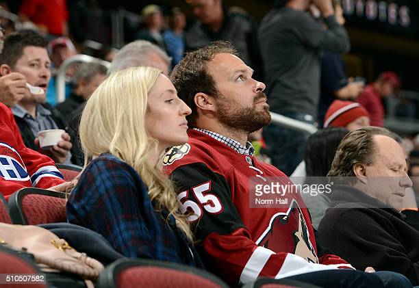 Arizona Diamondbacks pitcher Josh Collmenter watches a game between the Arizona Coyotes and Montreal Canadiens at Gila River Arena on February 15...