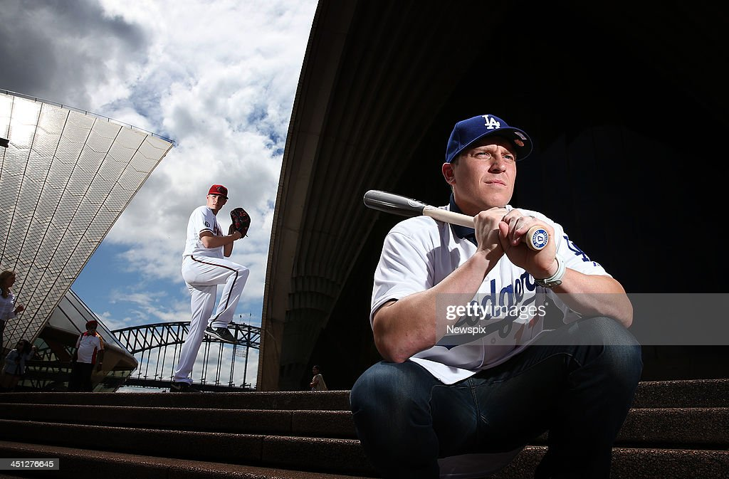 Arizona Diamondbacks Pitcher Patrick Corbin and LA Dodgers catcher AJ Ellis poses at the Sydney Opera House on November 19 2013 in Sydney Australia...