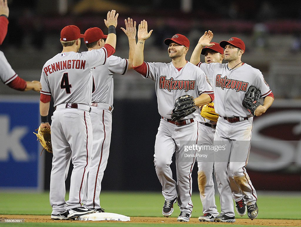 Arizona Diamondbacks players high-five after the Diamondbacks beat the San Diego Padres 8-1 in a baseball game at Petco Park on May 4, 2013 in San Diego, California.
