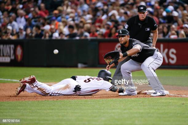 Arizona Diamondbacks right fielder Gregor Blanco dives back to first base to beat the tag from Chicago White Sox shortstop Tim Anderson during the...