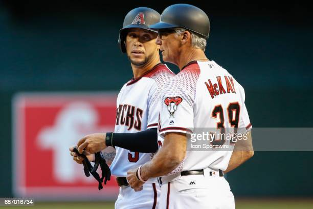 Arizona Diamondbacks right fielder Gregor Blanco talks to Arizona Diamondbacks first base coach Dave McKay after hitting a single during the MLB...