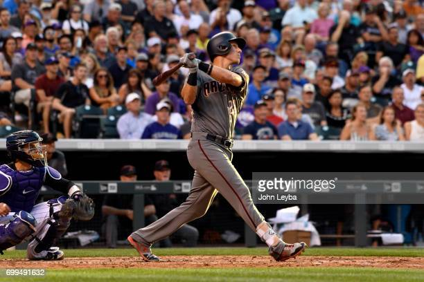 Arizona Diamondbacks third baseman Jake Lamb hits a two run double in the fourth inning agains the Colorado Rockies on June 21 2017 in Denver...